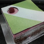 Katy Perry: Raspberry mousse, pistachio mousse, dark chocolate buttercream layers