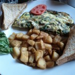 Spinach, Brie and mushroom omelette, note the lettuce garnish